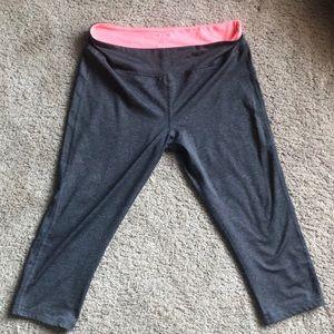 High wasted Grey/Coral calf length leggings.